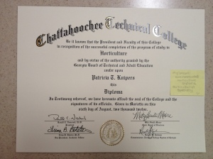 My diploma with original sticky note attached.